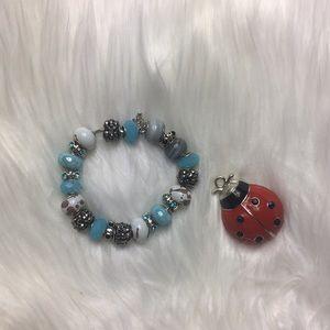 """Faux gem, 22 charm, silver tone bracelet, 10 1/2""""."""